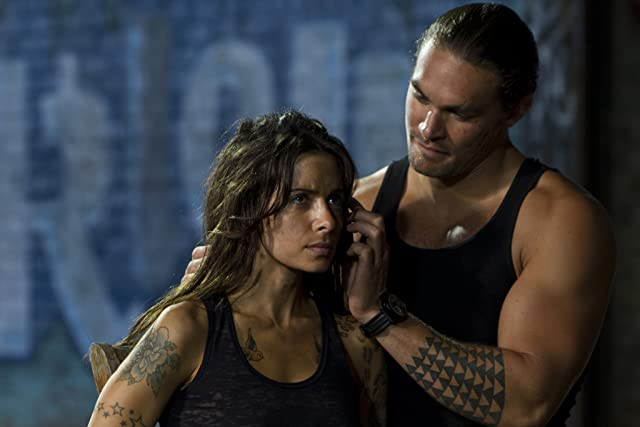 Jason Momoa and Sarah Shahi in Bullet to the Head (2012)
