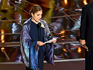 2017 Oscars Top Moments: Anousheh Ansari, the first Iranian to travel into space, accepts the Oscar for Best Foreign Language Film on behalf of Iranian director Asghar Farhadi, who boycotted the ceremony.