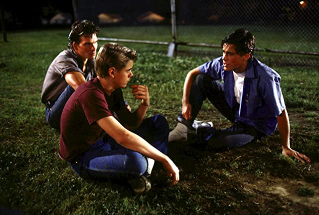 Rob Lowe, Patrick Swayze, and C. Thomas Howell in The Outsiders (1983)