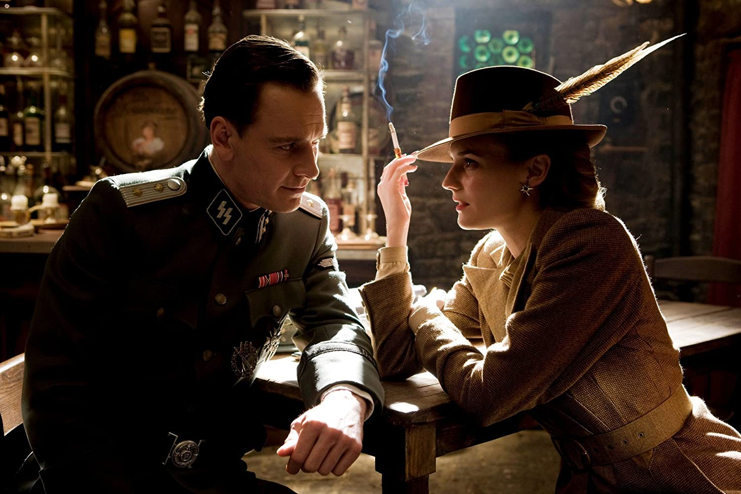 "Michael Fassbender as British Army Lieutenant ""Archie Hicox,"" personally picked out by Sir Winston Churchill to go undercover as a German Captain to obtain important information on the Third Reich from von Hammersmark regarding operation ""KINO"" and Diane Kruger as the popular UFA actress ""Bridget von Hammersmark"" in Quentin Tarantino's fictionalised WWII film, Inglourious Basterds (2009). It is through her connections that the Bastards are able to infiltrate Shosanna Dreyfus's cinema which will be occupied by most of the German high command."