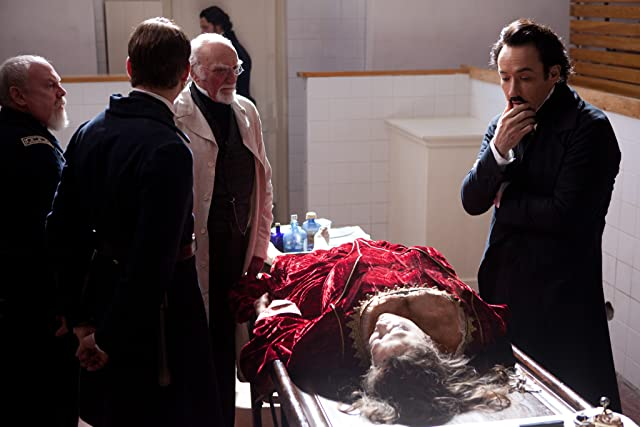 John Cusack and Jimmy Yuill in The Raven (2012)