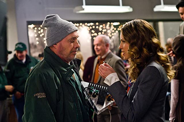 Hector Elizondo and Hilary Swank in New Year's Eve (2011)