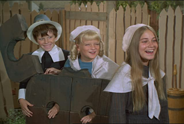 Susan Olsen, Mike Lookinland, and Maureen McCormick in The Brady Bunch (1969)