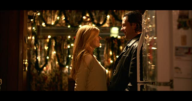 Connie Britton and Edward Burns in The Fitzgerald Family Christmas (2012)