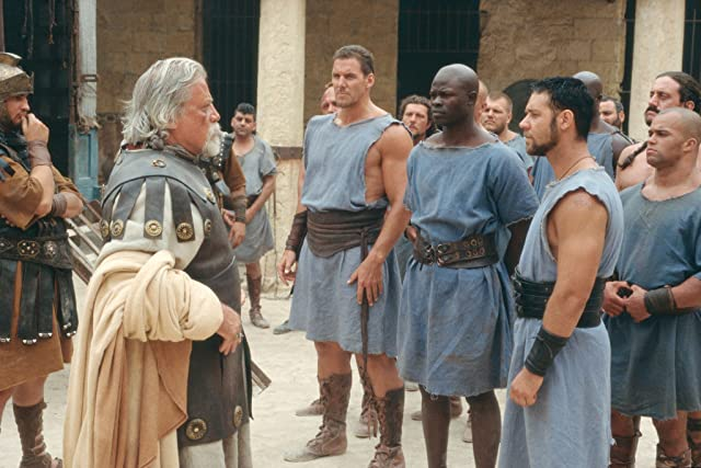 Russell Crowe, Oliver Reed, Djimon Hounsou, and Ralf Moeller in Gladiator (2000)