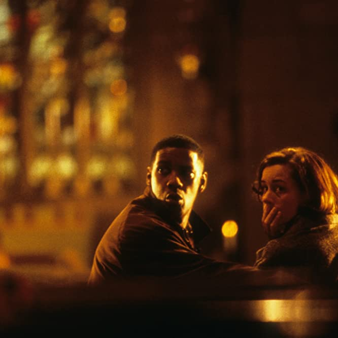 Denzel Washington and Embeth Davidtz in Fallen (1998)