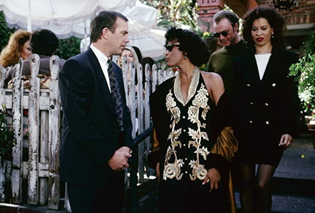 Kevin Costner, Whitney Houston, Gary Kemp, and Michele Lamar Richards in The Bodyguard (1992)
