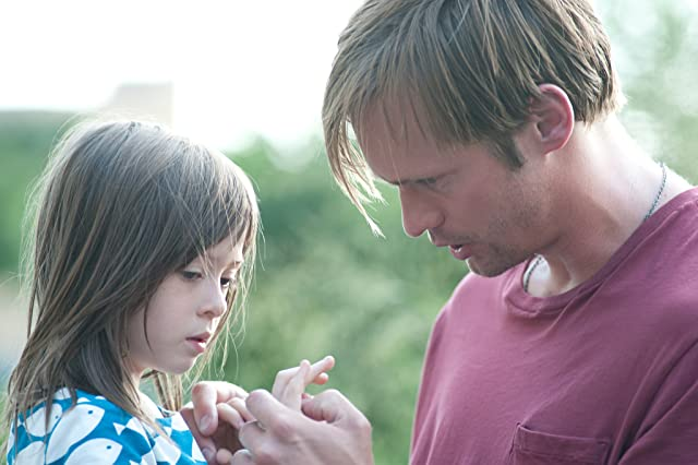 Alexander Skarsgård and Onata Aprile in What Maisie Knew (2012)