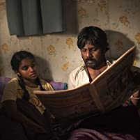 Jesuthasan Antonythasan and Claudine Vinasithamby in Dheepan (2015)