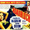 Joan Dixon and Charles McGraw in Roadblock (1951)
