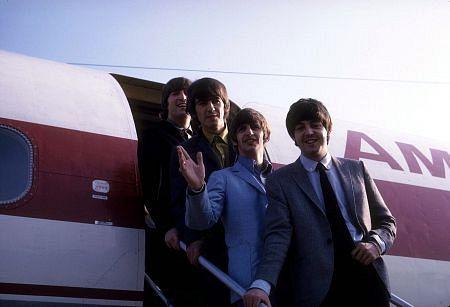 The Beatles, (John Lennon, George Harrison, Ringo Starr, Paul McCartney) getting off the plane.