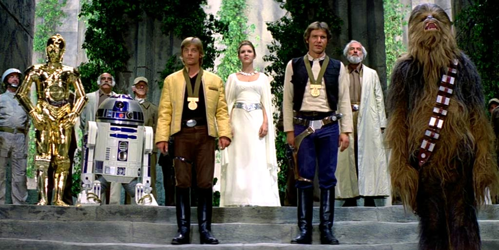 Harrison Ford, Anthony Daniels, Carrie Fisher, Mark Hamill, Kenny Baker, Peter Mayhew, and Alex McCrindle in Star Wars (1977)