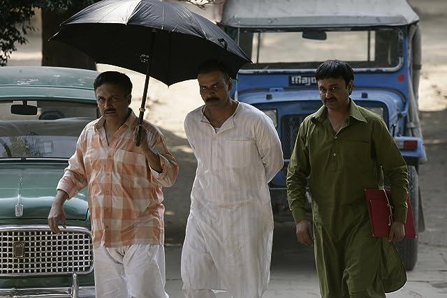 Manoj Bajpayee, Jameel Khan, and Piyush Mishra in Gangs of Wasseypur (2012)