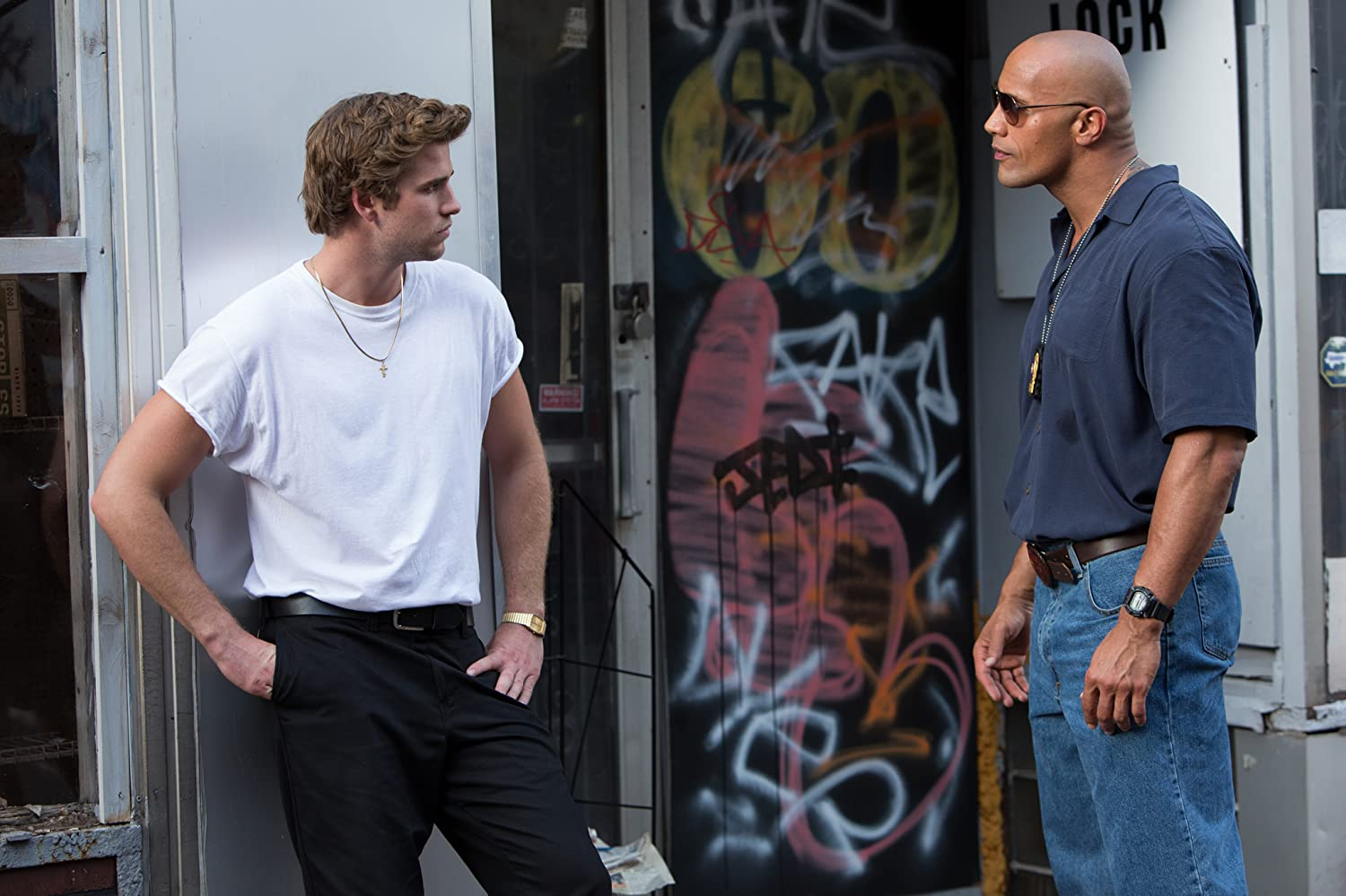 Dwayne Johnson and Liam Hemsworth in Empire State (2013)
