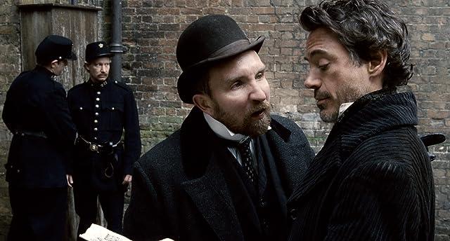 Robert Downey Jr. and Eddie Marsan in Sherlock Holmes (2009)
