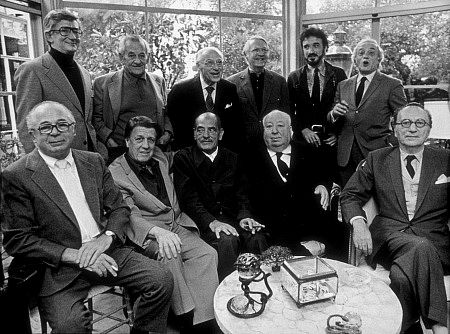 Directors Group, Nov. 1972. George Cukor Hosts a party for Luis Bunuel. Back Row from left: Robert Mulligan, William Wyler, George Cukor, Robert Wise, Jean-Claude Carriere, and Serge Silverman. Front Row from left: Billy Wilder, George Stevens, Luis Bunuel, Alfred Hitchcock, and Rouben Mamoulin.