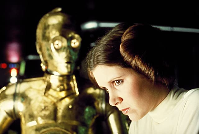 Anthony Daniels and Carrie Fisher in Star Wars: Episode IV - A New Hope (1977)
