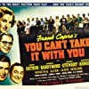James Stewart, Jean Arthur, Lionel Barrymore, Spring Byington, Eddie 'Rochester' Anderson, Edward Arnold, Mischa Auer, Mary Forbes, Samuel S. Hinds, Halliwell Hobbes, Donald Meek, Ann Miller, Dub Taylor, H.B. Warner, and Lillian Yarbo in You Can't Take It with You (1938)