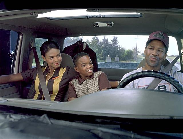 Denzel Washington, Kimberly Elise, and Daniel E. Smith in John Q (2002)