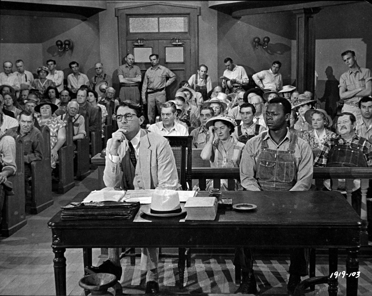 What happens to Tom Robinson following the trial in To Kill a Mockingbird?