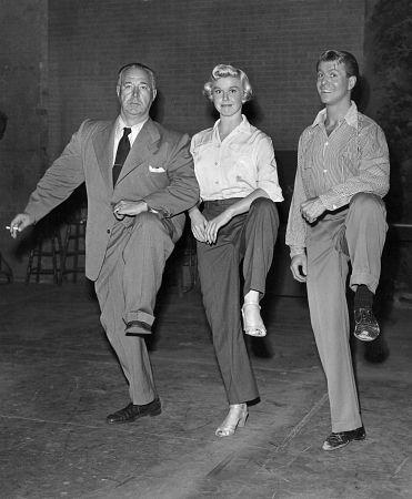 Doris Day, Gene Nelson, Director David Butler on the set of