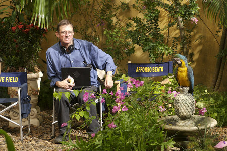 Director Mike Newell and Pacho, the parrot
