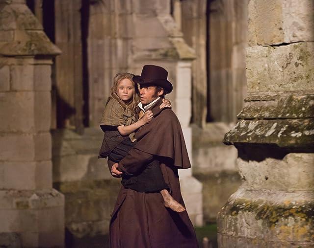 Hugh Jackman and Isabelle Allen in Les Misérables (2012)