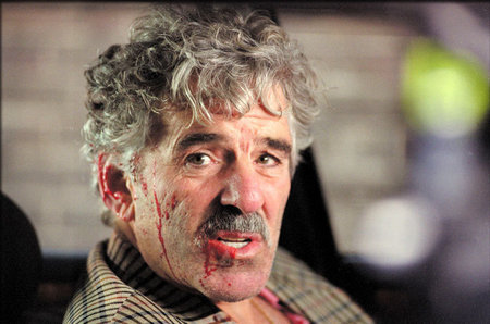 Tom Delmar Stunt Coordinator & Action Director. All beat up! Dennis Farina (Abraham 'Cousin Avi' Denovitz) in Guy Ritchie's 'Snatch'.jpg