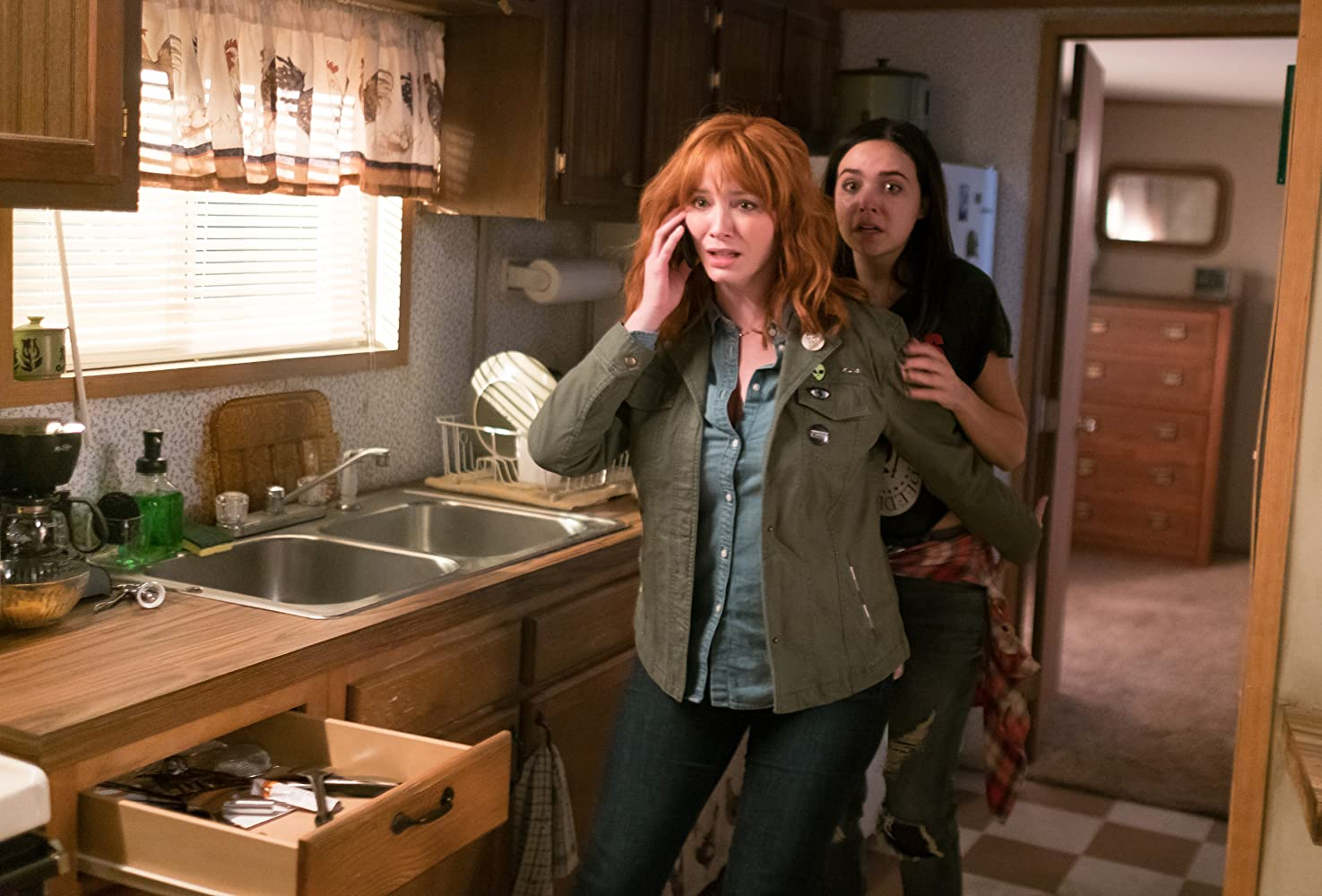 Christina Hendricks and Bailee Madison in The Strangers: Prey at Night (2018)