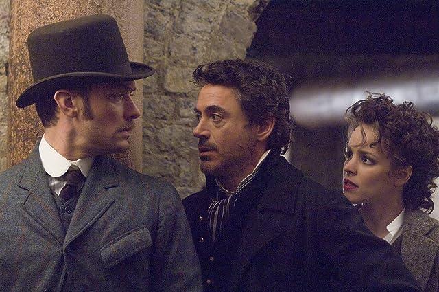 Jude Law, Robert Downey Jr., and Rachel McAdams in Sherlock Holmes (2009)
