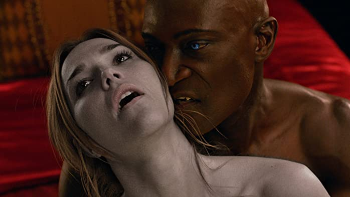 Arielle Kebbel and Peter Mensah in Midnight, Texas (2016)