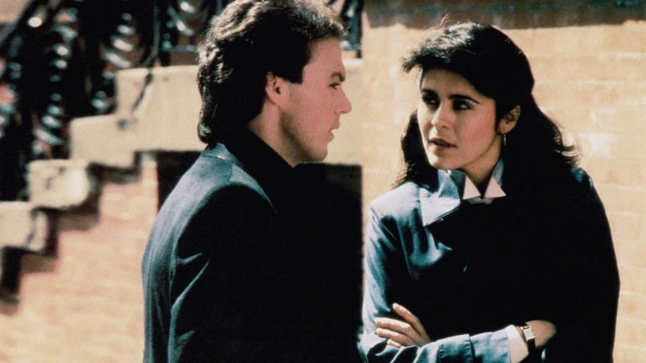 Michael Keaton and Maria Conchita Alonso in Touch and Go (1986)