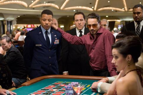 Robert Downey Jr., Terrence Howard, and Jon Favreau in Iron Man (2008)