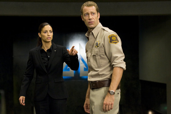 Colin Ferguson and Erica Cerra in Eureka (2006)