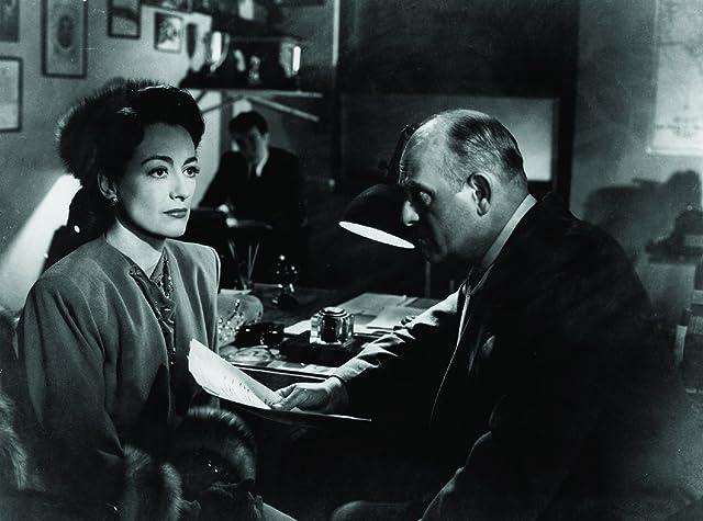 Joan Crawford and Moroni Olsen in Mildred Pierce (1945)