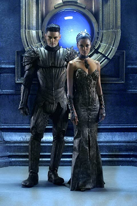 Thandie Newton and Karl Urban in The Chronicles of Riddick (2004)