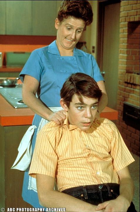 Ann B. Davis and Barry Williams in The Brady Bunch (1969)