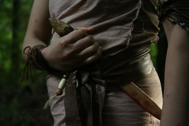 Sheenyana (Yvette Lu) pulls her dagger for the kill.