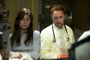 Maura Tierney and Scott Grimes in ER (1994)