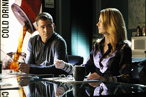 Marg Helgenberger and George Eads in CSI: Crime Scene Investigation (2000)
