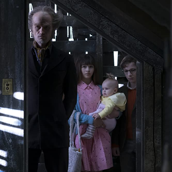 Neil Patrick Harris, Malina Weissman, Louis Hynes, and Presley Smith in A Series of Unfortunate Events (2017)