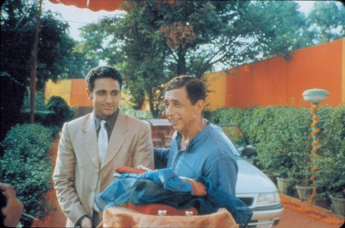 Hemant Rai (Parvin Dabas) is welcome by his father-in-law-to-be Lalit Verma (Naseeruddin Shah) at the latter's home in the Mira Nair film MONSOON WEDDING, an Odeon Films Inc. release.