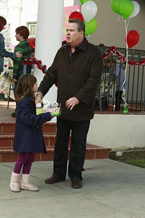 Eric Stonestreet and Aubrey Anderson-Emmons in Modern Family (2009)