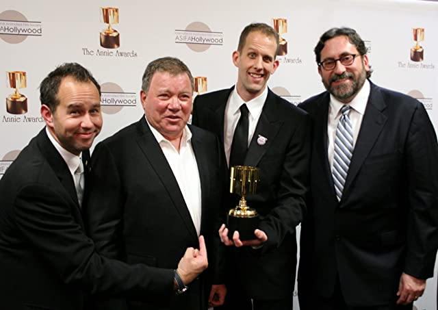 Animated feature winners Jonas Rivera, Pete Docter, and Bob Peterson with presenter (and event host) William Shatner