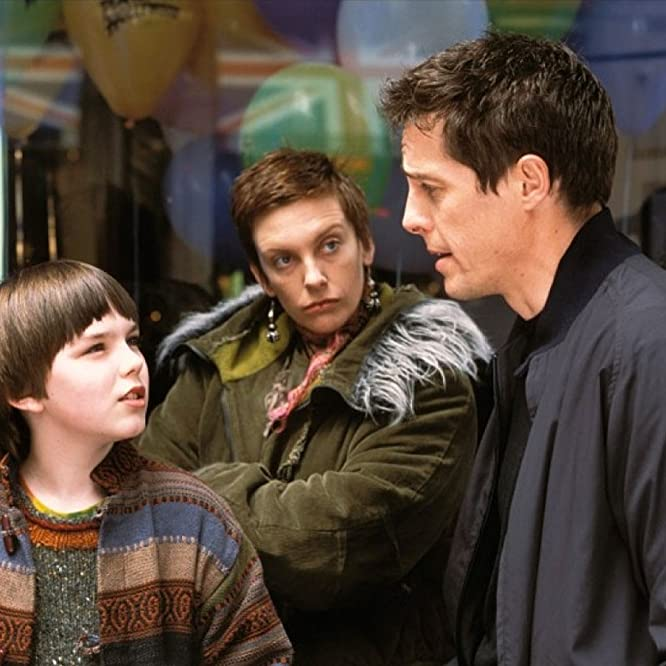 Hugh Grant, Toni Collette, and Nicholas Hoult in About a Boy (2002)