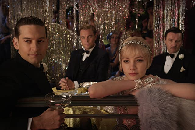 Leonardo DiCaprio, Tobey Maguire, Joel Edgerton, and Carey Mulligan in The Great Gatsby (2013)