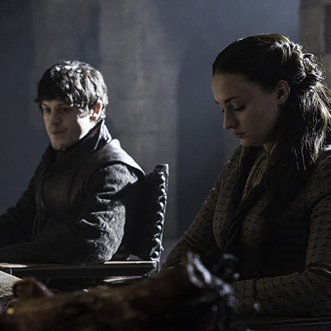 Iwan Rheon and Sophie Turner in Game of Thrones (2011)