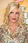 Tori Spelling Looks Super Skinny in Horizontal Stripe Dress as Mystery Girls Teaser Trailer Debuts