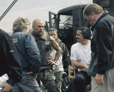 Matthew McConaughey (second from left) chats with the crew during a break in filming. Directed by Rob Bowman.