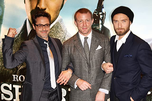 Jude Law, Robert Downey Jr., and Guy Ritchie at Sherlock Holmes: A Game of Shadows (2011)